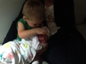 Ryan holding his new brother